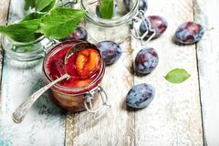 Plums jam fresh fruits Marmalade. Plums jam with fresh fruits on wooden background. Marmalade preparing Royalty Free Stock Photo