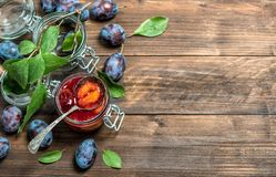Plums jam rustic wooden background Fruit marmalade. Plums jam on rustic wooden background. Fruit marmalade Stock Images