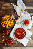 Plums jam in a small cup. Homemade spicy mirabelle, greengage pl Stock Photo