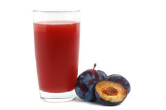 Plums juice Stock Photos