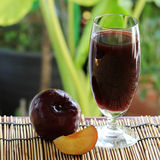 Plums Juice Stock Photography