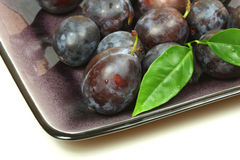 Plums with leaf Stock Images