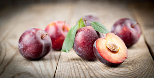 Plums with leaves Stock Photos