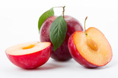 Plums with leaves Royalty Free Stock Image