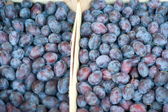 Plums at a market Stock Photo