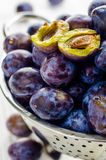 Plums. In a metal bowl Stock Photo