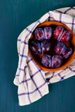 Plums on a napkin. On the board Stock Photography
