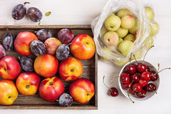 Plums, nectarines, cherries. Studio still life of fruit and berries: cherries, plums and nectarines stock image