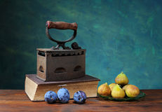 Plums and old iron Stock Photo