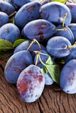 Plums on an old wooden table. Royalty Free Stock Photography