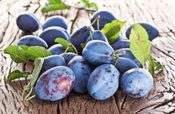 Plums on an old wooden table. Stock Photography