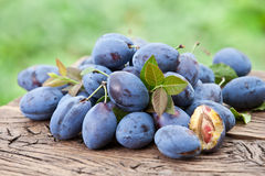 Plums on an old wooden table. Royalty Free Stock Photo