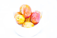 Plums orange on a white background Royalty Free Stock Photography