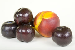 Plums and Peach Royalty Free Stock Images