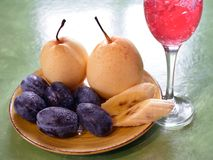 Plums pears and wineglass Stock Photo
