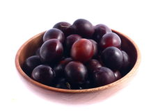 Plums on plate Stock Photos
