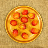Plums on plate Stock Image