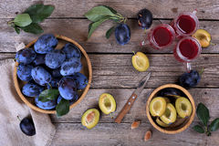 Plums and plum juice Stock Photo