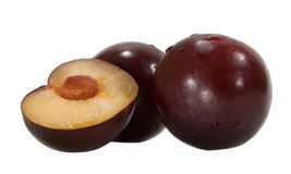 Plums with pulp and stone Royalty Free Stock Images
