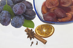 Plums in red wine Stock Photo