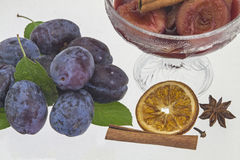 Plums in red wine Stock Image