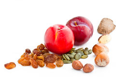 Plums seeds and nuts Royalty Free Stock Photography