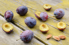 Plums on shabby wooden table Stock Image