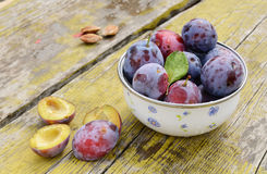 Plums on shabby wooden table Royalty Free Stock Photo