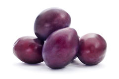 Plums. Some ripe plums on a white background Royalty Free Stock Photo