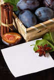 Plums and spices. Royalty Free Stock Photo