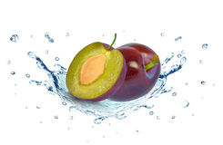 Plums splash water Royalty Free Stock Photography