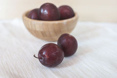 Plums on a table. Fresh delicious organic plums lying on a table. Selectve focus Stock Image