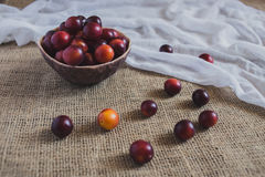 Plums on the table Stock Photos