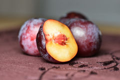 Plums on tablecloth close up Royalty Free Stock Image