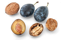 Plums & walnuts Royalty Free Stock Photography