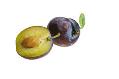 Plums on white background. Plums whole and half on white background Stock Image