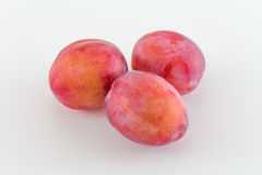 Plums on white background royalty free stock photo