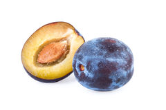 Plums on white background Stock Photos