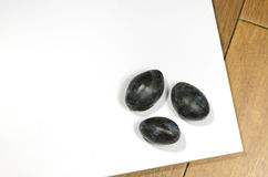 Plums on a white board Stock Image