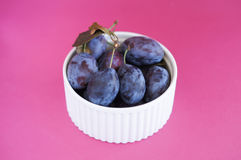 Plums in white bowl Royalty Free Stock Photography