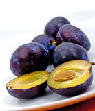Plums on the white plate Royalty Free Stock Photography