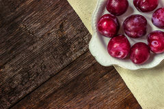 Plums in white plate Stock Photography