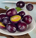 Plums on  white plate Royalty Free Stock Images
