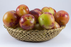 Plums wickerwork oval shape Royalty Free Stock Image