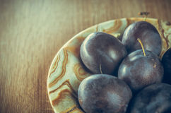 Plums. On wood backround Stock Photography