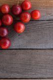 Plums on a wooden board Stock Image
