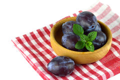 Plums in the wooden bowl Royalty Free Stock Photos