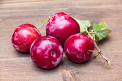 Plums on wooden Stock Photo