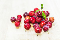 Plums on wooden Royalty Free Stock Image