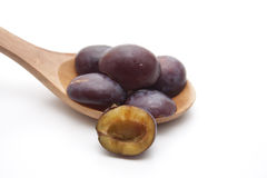 Plums  on wooden spoon Stock Photo